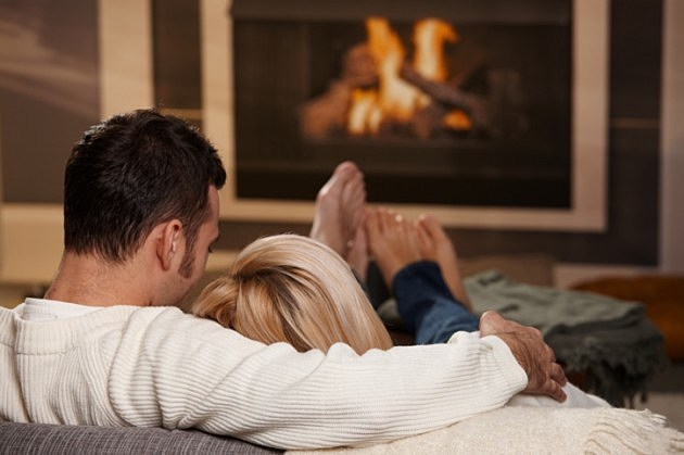 cuddling by fireplace