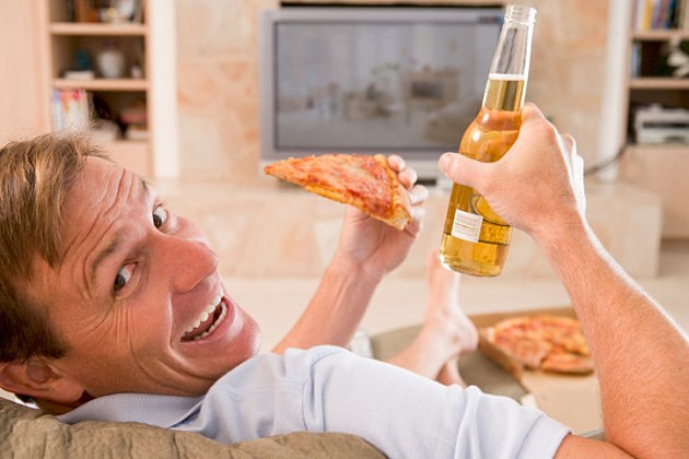 guy eating pizza and beer