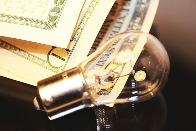Lamp and banknotes as energy saving concept idea