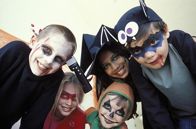 Portrait of children in Halloween costumes