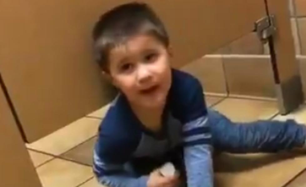 Kid Crawls Under Bathroom Stall To Seek Help From Stranger VIDEO - Boy crawls under bathroom stall